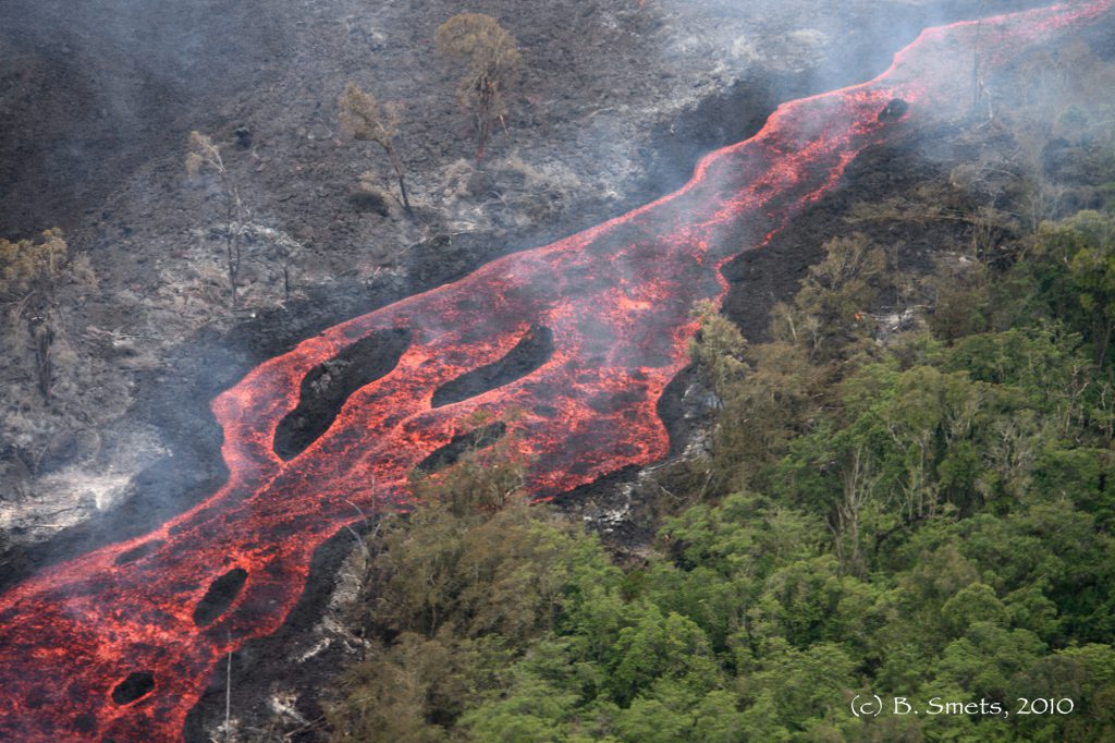 Figure 1: Active lava flow channel burning the dense forst of the Virunga National Park during hte January 2010 eruption of Nyamulagira. Photo (c) B. Smets, RMCA, 2010.